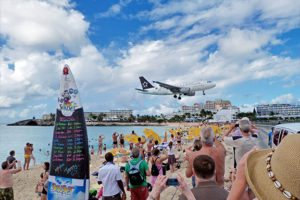 Watch as airplanes descend down right above your head while on the beach at St. Maarten!